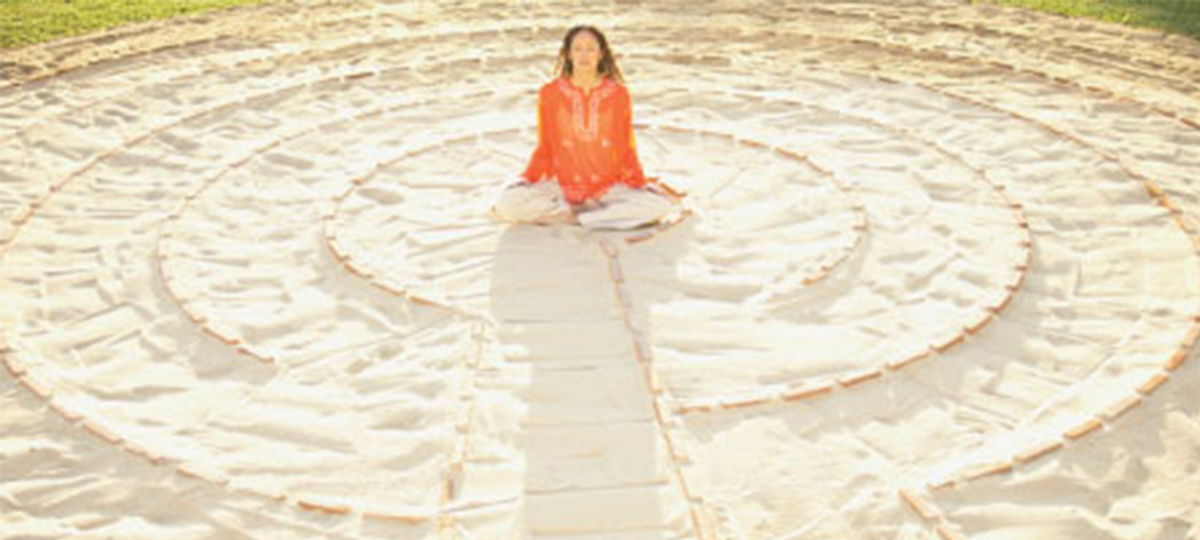 woman sitting in a circle in mediation pose
