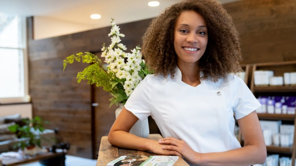female spa employee at front desk