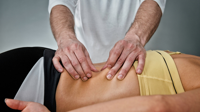 massage therapist performing fascial therapy on client