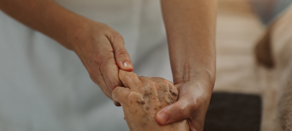 Close up of massage on elderly hand