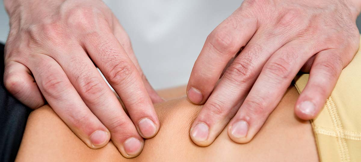 Close up of hands on back rolling skin
