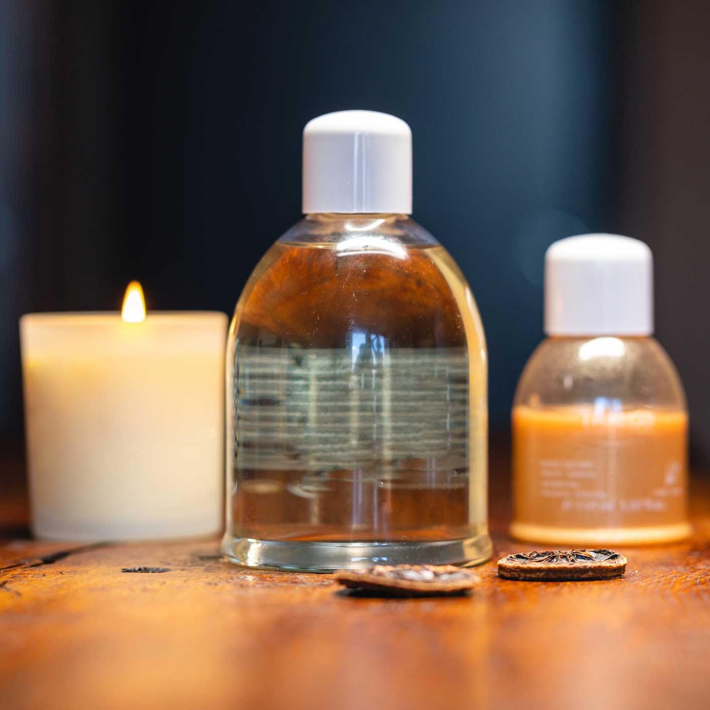 candle and bottles of massage oil